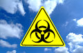 Bio hazard sign in blue sky Stock Images