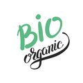 Bio organic hand written inscription on green
