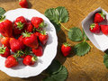Bio strawberries on the table fresh in white plate Royalty Free Stock Images