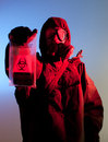 Bio warfare fear biohazard soldier holding biohazard bag Stock Photography