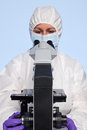 Biochemist looking at a microscope Royalty Free Stock Photography