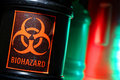 Biohazard Label on Dangerous Waste Container Stock Images