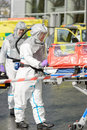 Biohazard medical team with stretcher on street wear protective uniform Royalty Free Stock Photography