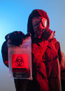 Biohazard soldier holding bag Stock Photos