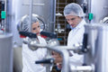 Biologist team talking and wearing hairnet Royalty Free Stock Photo