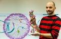 Biology teacher showing DNA model