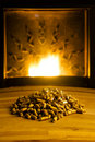 Biomass pellets illuminated by flame from heater Royalty Free Stock Photos