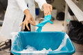 Biomedical trash closeup cropped portrait healthcare professional throwing away blue disposable latex gloves in infection control Stock Images