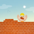Bird builds brick wall Royalty Free Stock Photo