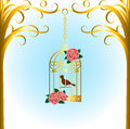 Bird cage vintage hanging on tree branch Royalty Free Stock Image