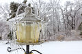 Bird feeder covered in ice a northern virginia backyard and icicles Stock Photo