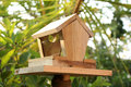 Bird feeder lovely mad of wood Royalty Free Stock Photos