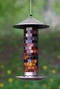 Bird feeder multi colored glass in the backyard Royalty Free Stock Photography