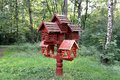 Bird feeders in the form of houses in the park Stock Photography