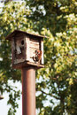 Bird feeders tree house for the birds feeding her yound ones young Royalty Free Stock Image