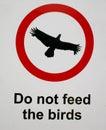 Bird feeding sign Royalty Free Stock Photo