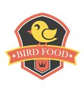 Bird food emblem with a shield containing a cute little yellow cartoon canary perched on a banner containing the text Stock Photography