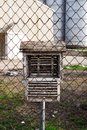 Bird house and chain link fence Stock Photos