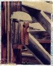 Bird house on an old barn - Polaroid image transfe Stock Photo