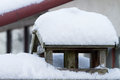 Bird house with snow cover winter time Royalty Free Stock Image