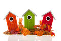 Bird houses with seed and leaves Royalty Free Stock Photo