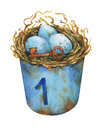 Bird nest with blue eggs in a rusty metal buckets, home decor for Easter.