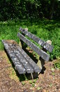 Bird poo droppings nuisance at bench in park Stock Photo