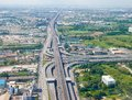 Bird`s-eye view on highway in Bangkok vicinity Royalty Free Stock Photo
