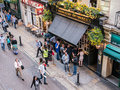 Bird's-eye view of London pub, patrons outside