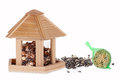 Bird seed in a bird box with a fat ball Royalty Free Stock Photo