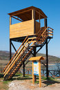 Bird watching tower a and an informative billboard made out of wood in a protected wetland Royalty Free Stock Image
