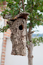 Birdhouse made from the bark of a tree hung Royalty Free Stock Photo