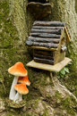 Birdhouse and mushroom in forest scene Stock Photography