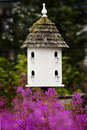 Birdhouse and Pink Flowers Royalty Free Stock Photo