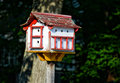 Birdhouse red and white on a wooden post Stock Photos