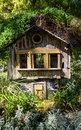 Birdhouse rustic old in garden Royalty Free Stock Photos