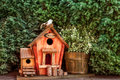 Birdhouse a welcome whit a bird on the roof Royalty Free Stock Images