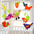 Birds baby crib mobile in nursery Stock Images