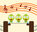 Birds choir cartoon singing on an electric wire Stock Photo