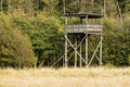 Birdwatching tower a large in a nature reserve is built of wood and a staircase leads up to the top floor under a roof Stock Photo