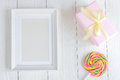 Birth of child - blank picture frame on wooden background Royalty Free Stock Photo