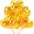 Birthday balloons heart shaped yellow Stock Photography