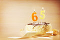 Birthday cake with burning candle as a number sixty five focus on the Royalty Free Stock Image