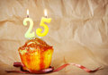 Birthday cake with burning candles as number twenty five Royalty Free Stock Photo