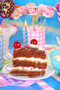 Birthday cake with candle on festive table Stock Photo
