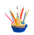 Birthday cake with candles burning isolated on white background Stock Photos