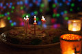 Birthday cake with candles and colorful bokeh