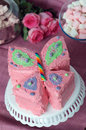 Birthday cake pink butterfly party for girl with fairy dust sprinkles marshmallows and pink roses in the background Stock Photography