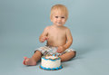 Birthday cake smash baby blue studio background white with sprinkles Royalty Free Stock Photos