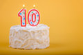 Birthday cake with ten on it in candles Royalty Free Stock Photo